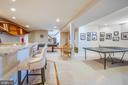 Long granite countertops w/ room for barstools - 5916 DEEP CREEK DR, FREDERICKSBURG