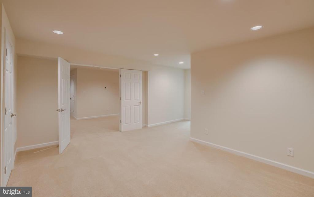 Guest Room in Basement with Recessed Lighting - 336 WINDERMERE DR, STAFFORD