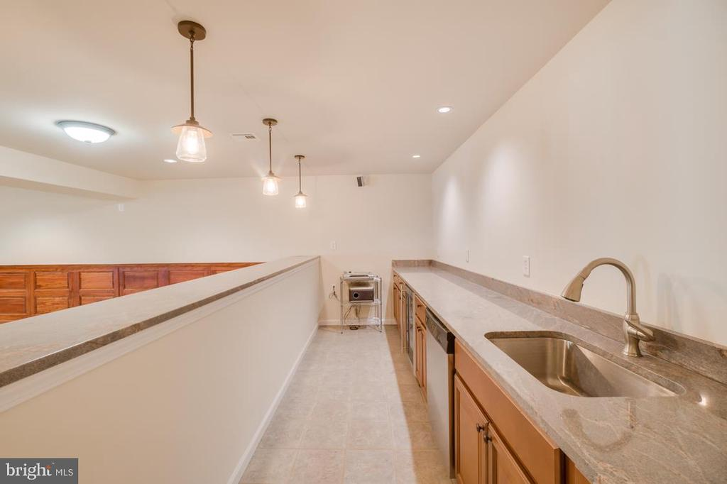 Bar/Kitchen in Basement- with wine fridge and sink - 336 WINDERMERE DR, STAFFORD