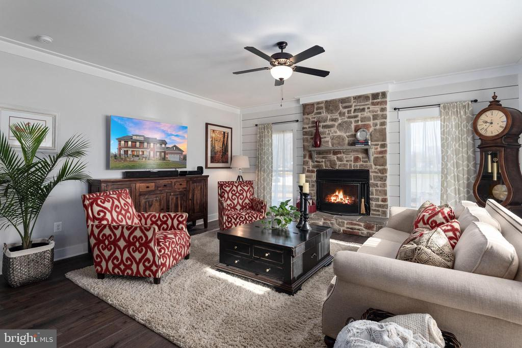 Family room w/ floor to ceiling stone fireplace. - 79 INDIAN POINT RD, STAFFORD