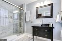 Renovated full bathroom. - 4601 QUEENSBURY RD, RIVERDALE