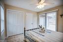 Bedroom with door onto back deck - 3704 LAKEVIEW PKWY, LOCUST GROVE