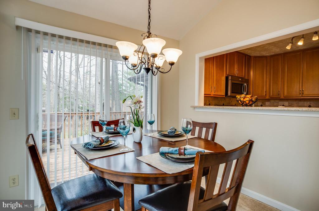 Dining room with door onto deck - 3704 LAKEVIEW PKWY, LOCUST GROVE