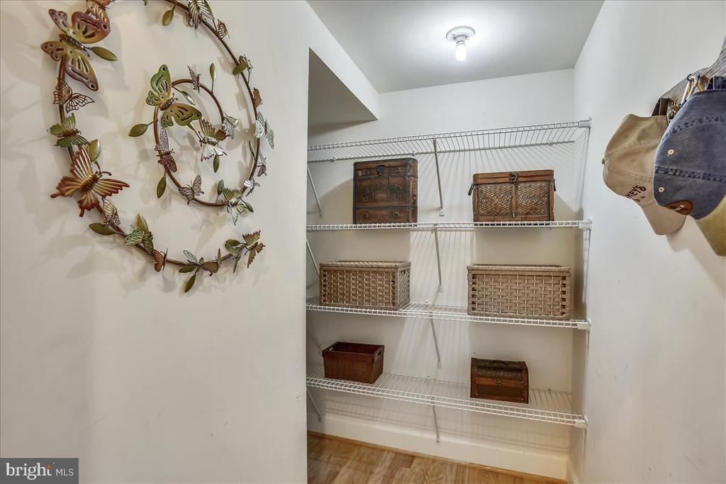 New shelves in hall closet for storage/pantry - 44482 MALTESE FALCON SQ, ASHBURN