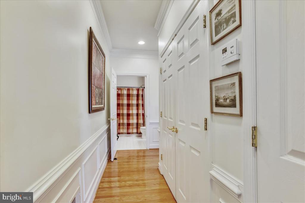 hallway with crown molding & washer/dryer area - 44482 MALTESE FALCON SQ, ASHBURN