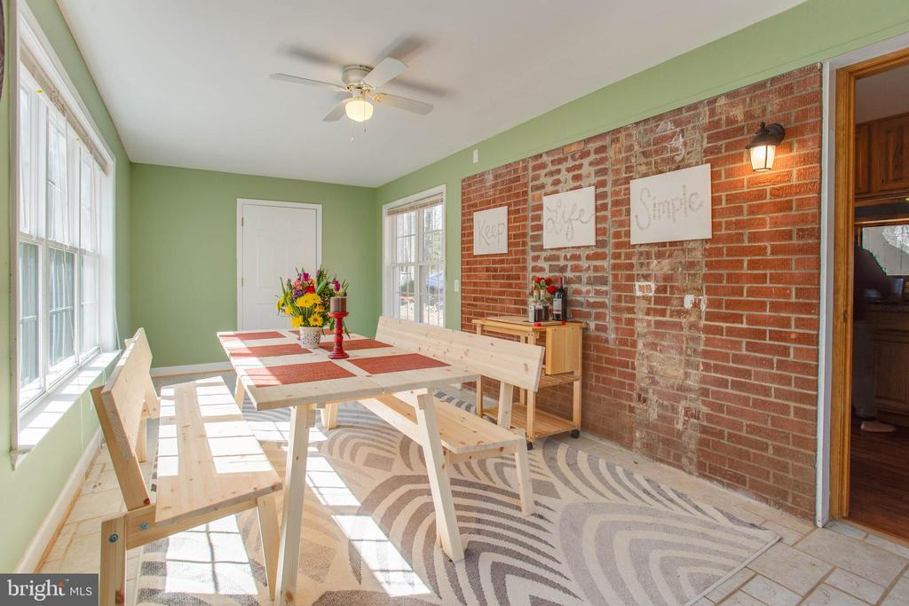 Light and bright sunroom with exposed brick wall - 5755 PILGRIMS REST RD, BROAD RUN