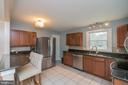 Remodeled kitchen with granite and SS appliances - 180 S HUGHES ST, HAMILTON