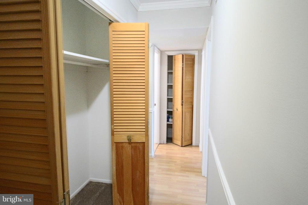 Large Hall closet and full linen closet. - 5091 7TH RD S #102, ARLINGTON