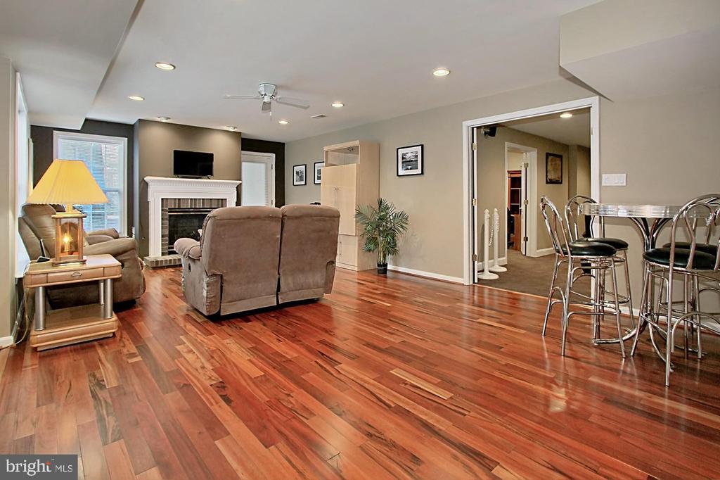 Walk-Out Recreation Room With Hardwood Floors - 42669 SILVERTHORNE CT, BROADLANDS