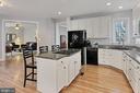 Kitchen off family room - 42603 GOOD HOPE LN, BRAMBLETON