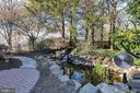Tranquil waterfall & pond - 5597 CEDAR BREAK DR, CENTREVILLE
