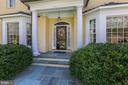 The gracious entry is lined with mature boxwoods - 224 W WINDSOR AVE, ALEXANDRIA