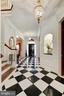 Marble foyer leads to first staircase - 224 W WINDSOR AVE, ALEXANDRIA