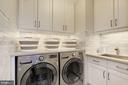 Laundry room is marble tiled w/ lots of storage - 224 W WINDSOR AVE, ALEXANDRIA