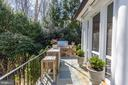 View of side yard and built-in Wolf grill - 224 W WINDSOR AVE, ALEXANDRIA