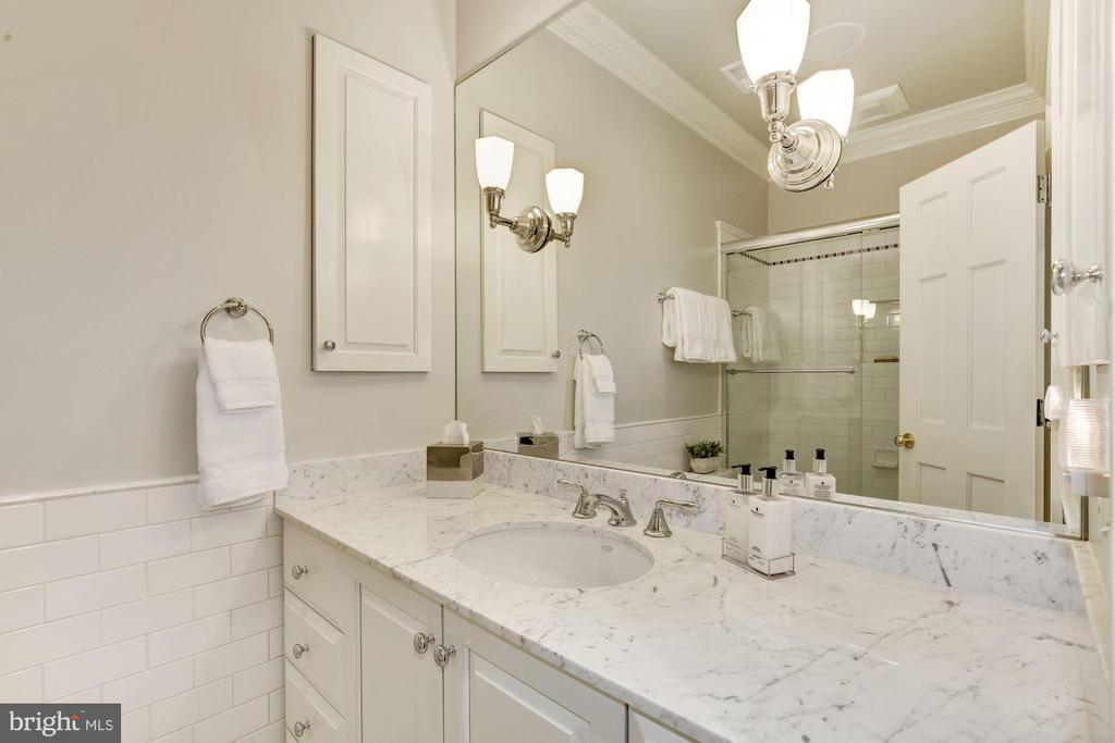 Hall bath has tub w/ glass doors & marble vanity - 224 W WINDSOR AVE, ALEXANDRIA