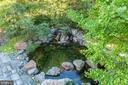 Custom designed pond with boulders to walk across - 9110 DARA LN, GREAT FALLS