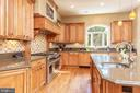 Gourmet kitchen with 3 dishwashers & 3 ovens - 9110 DARA LN, GREAT FALLS