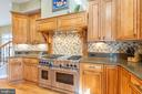 Wolf Gas stove with hood and 2 ovens - 9110 DARA LN, GREAT FALLS