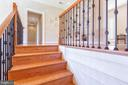 Landing at top of stairs with built-in bookshelves - 9110 DARA LN, GREAT FALLS