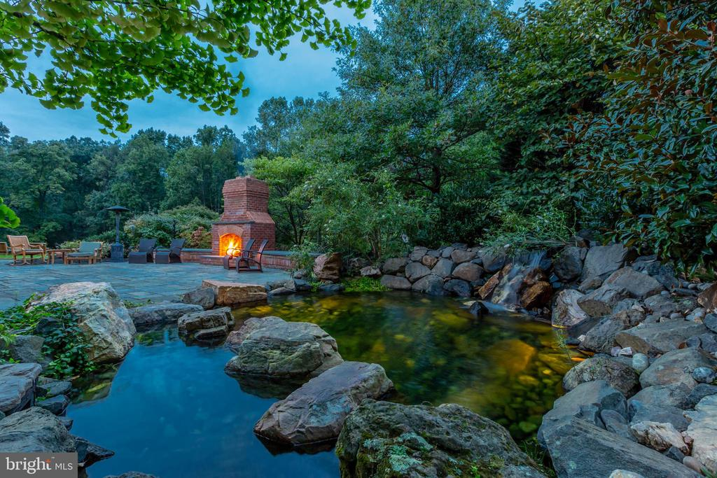 Custom pond with waterfall and fireplace - 9110 DARA LN, GREAT FALLS