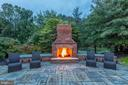 Outdoor fireplace, sitting area - 9110 DARA LN, GREAT FALLS