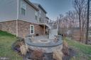 Custom firepit with built-in seating - 12472 SOUTHINGTON DR, WOODBRIDGE