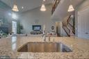 Kitchen with modern lighting - 12472 SOUTHINGTON DR, WOODBRIDGE