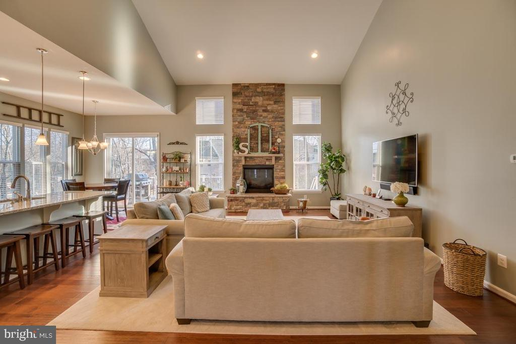Huge stone fireplace - 12472 SOUTHINGTON DR, WOODBRIDGE