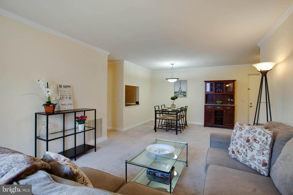 View of living room and dining room - 18318 STREAMSIDE DR #203, GAITHERSBURG