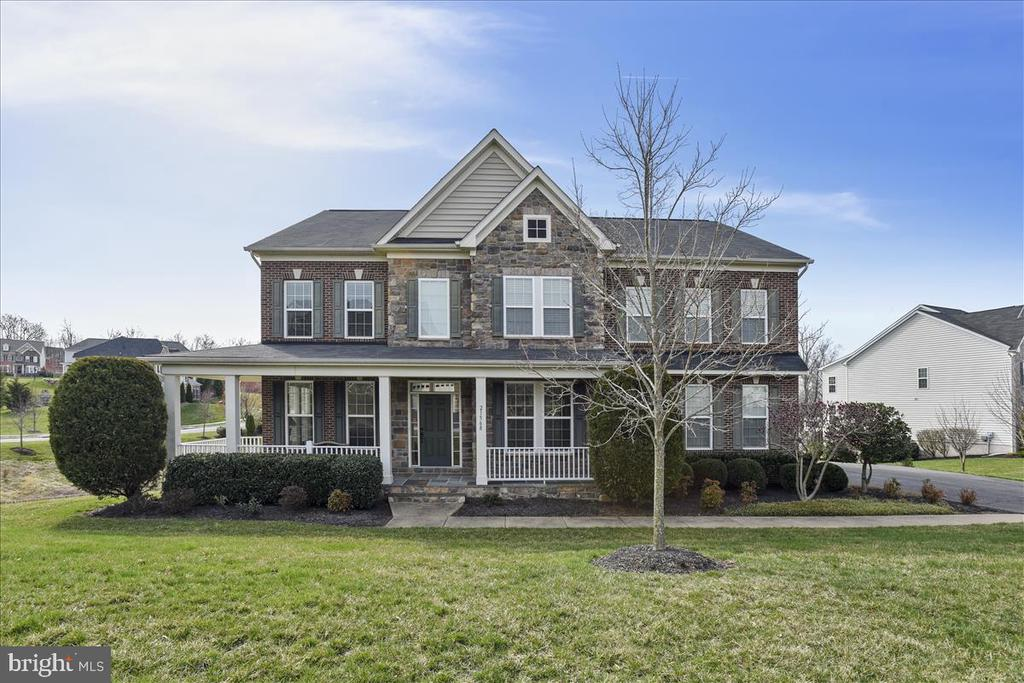 Stone front with porch. - 21568 BURNT HICKORY CT, BROADLANDS