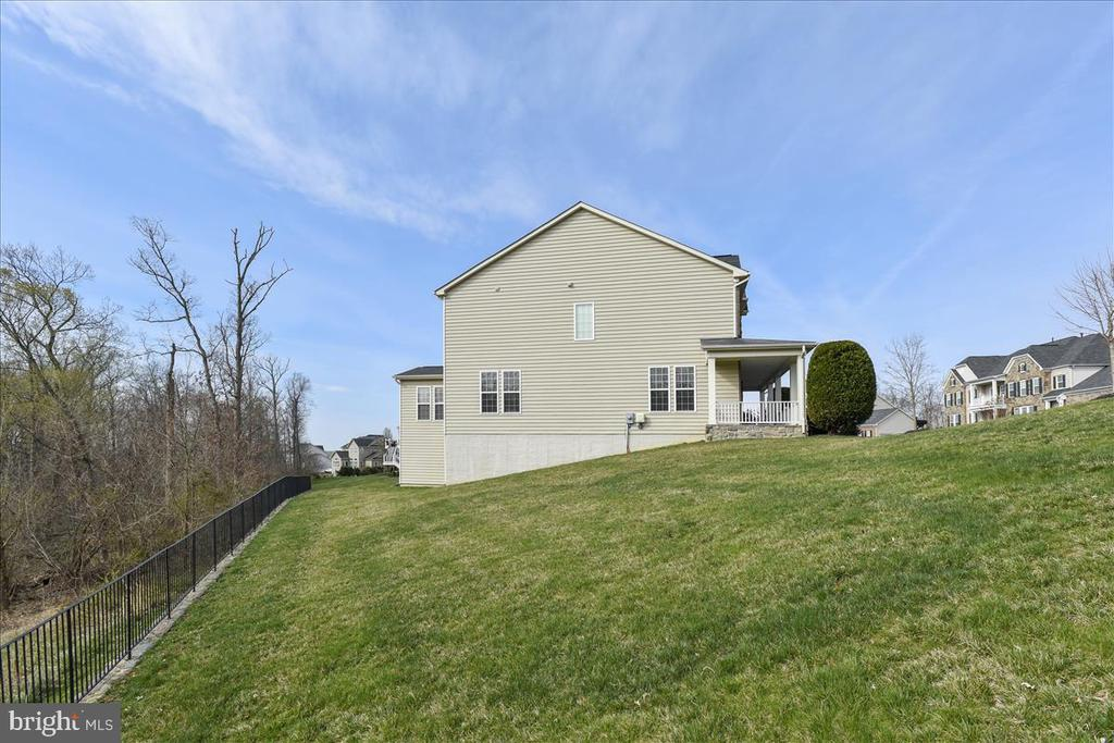 The retaining wall leads to the rest of the land. - 21568 BURNT HICKORY CT, BROADLANDS