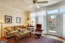 Family room with exit to balcony - 10884 SYMPHONY PARK DR, NORTH BETHESDA