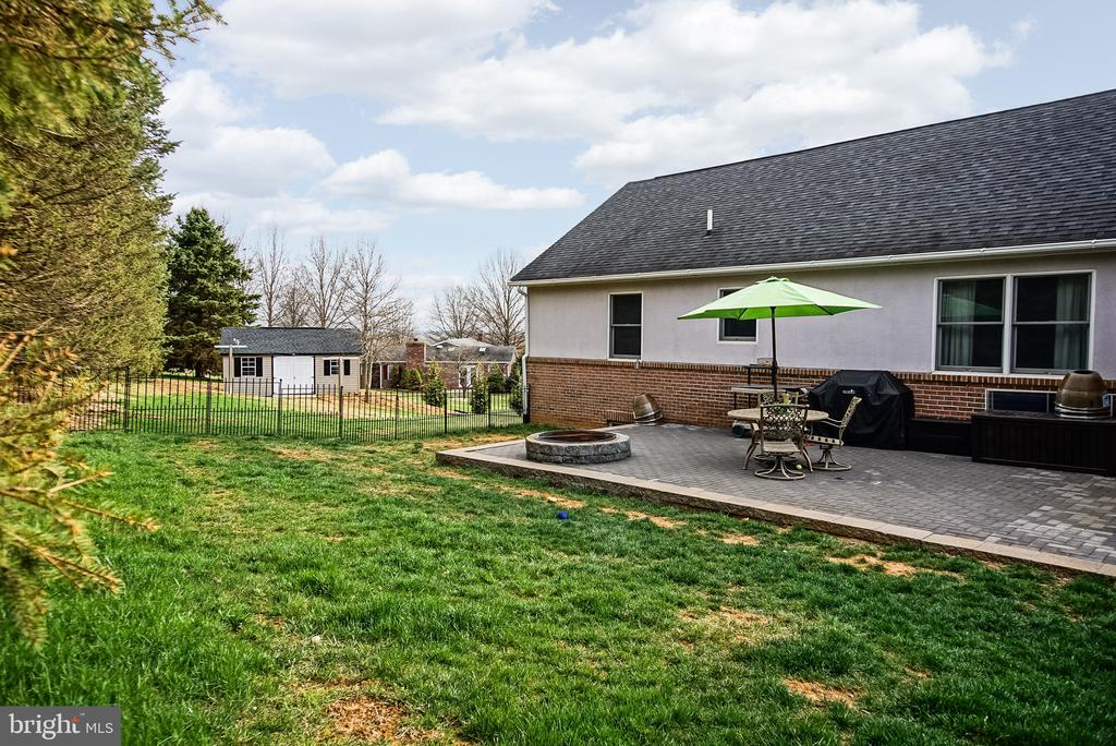 Fenced in back yard with paver patio. - 9154 MYERSVILLE RD, MYERSVILLE
