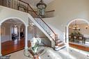 Grand marble foyer - 8033 WOODLAND HILLS LN, FAIRFAX STATION