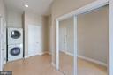 Main floor laundry room/mud room - 8033 WOODLAND HILLS LN, FAIRFAX STATION