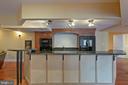 basement with bar - 8033 WOODLAND HILLS LN, FAIRFAX STATION