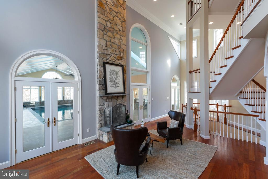 2nd family room with 2 sided fireplace off pool - 8033 WOODLAND HILLS LN, FAIRFAX STATION