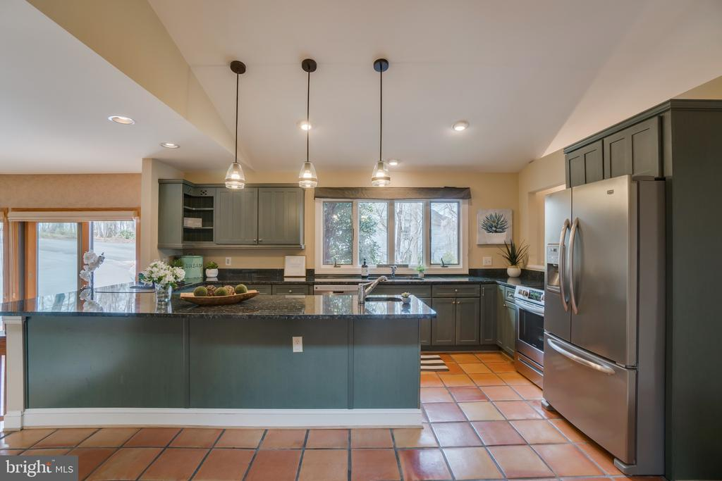 Have a seat at the bar in this EXPANSIVE Kitchen! - 232 BEACHSIDE CV, LOCUST GROVE