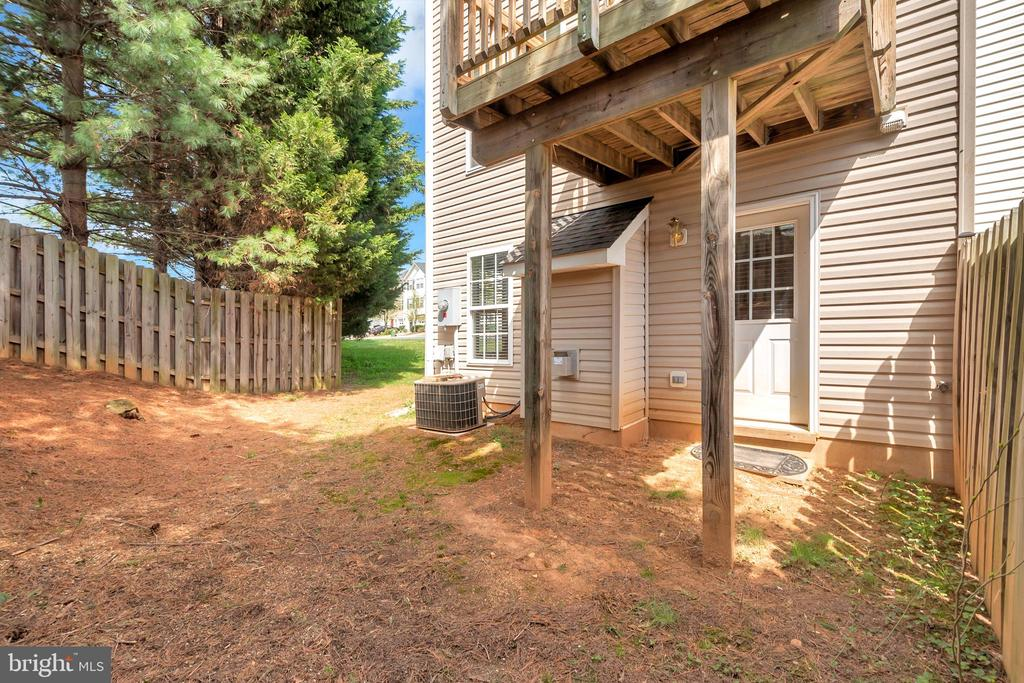 Rearview of  w/trees & partia l privacy fence - 10019 GANDER CT, FREDERICKSBURG