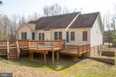 Expansive decking along rear of home - 7407 BARRISTER CT, SPOTSYLVANIA