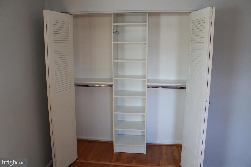 BR closet organizer - 9005 CHERRYTREE DR, ALEXANDRIA