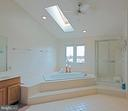 Master bathroom separate shower, vaulted ceiling - 5312 MAPLE VALLEY CT, CENTREVILLE