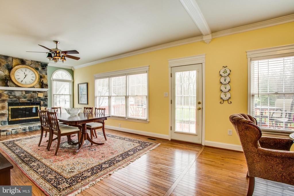 Family room with stone fireplace - 8202 WATERFORD DR, SPOTSYLVANIA