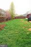 Landscaped fenced yard with trees - 10212 NAPOLEON ST, FREDERICKSBURG