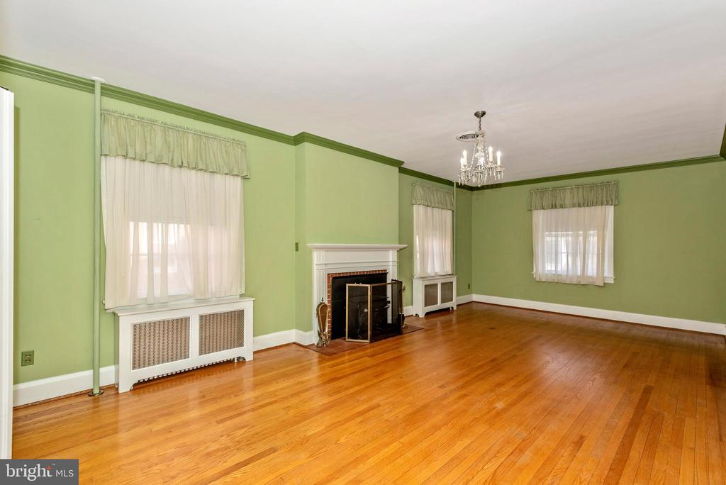Living room with fireplace. - 202 ROCKWELL TER, FREDERICK
