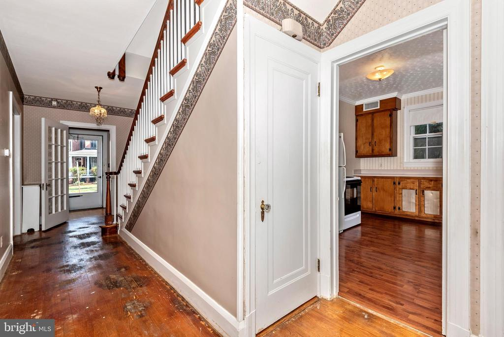 Center hall and access door to basement.~ - 202 ROCKWELL TER, FREDERICK