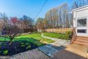 Landscaped garden with hardscape. - 202 ROCKWELL TER, FREDERICK