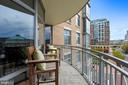 Spacious wraparound balcony perfect for cocktails! - 11990 MARKET ST #413, RESTON