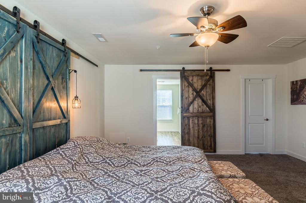 Master bedroom doors to bath and closet - 17040 TAKEAWAY LN, DUMFRIES